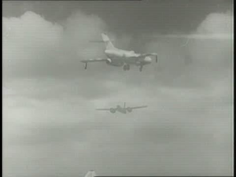 military jets take off and land; a rocket is launched from a ramp. - gammalmodig bildbanksvideor och videomaterial från bakom kulisserna
