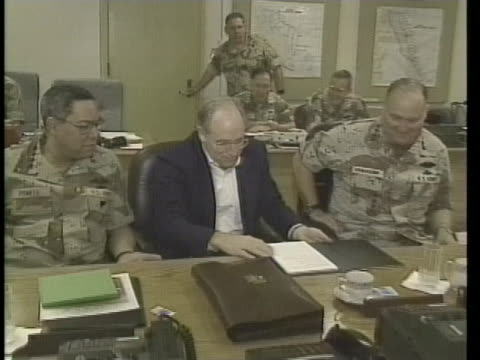 military leaders colin powell norman schwarzkopf and richard cheney meet in riyadh saudi arabia during operation desert storm - (war or terrorism or election or government or illness or news event or speech or politics or politician or conflict or military or extreme weather or business or economy) and not usa video stock e b–roll