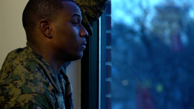 Military Man Gazes out the Window