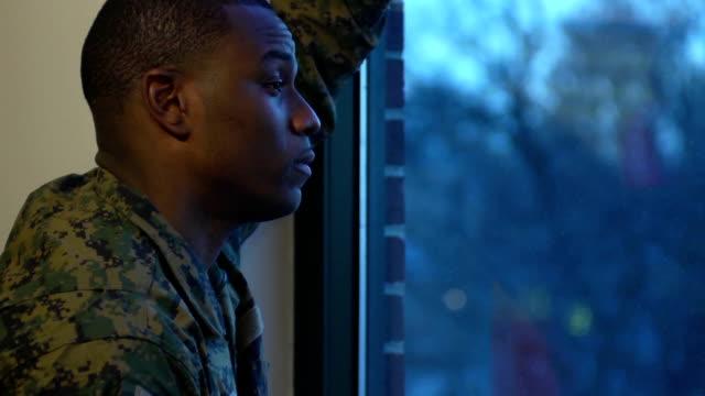 stockvideo's en b-roll-footage met military man gazes out the window - leger krijgsmacht