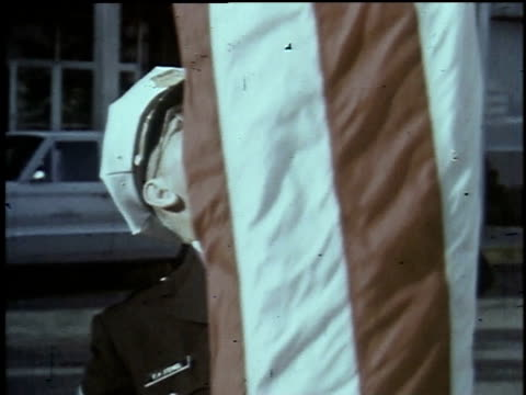 1965 montage military man raising the united states flag / united states - saluting stock videos & royalty-free footage
