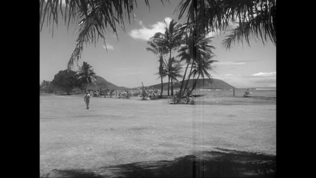 vidéos et rushes de ws military man walking on beach / united states - océan pacifique