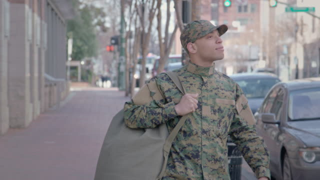 military man walks on urban street setting - war veteran stock videos & royalty-free footage