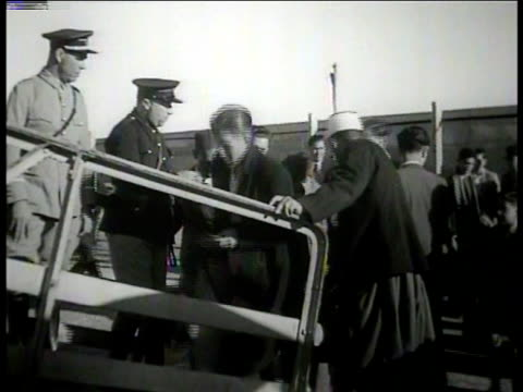 deportation military men civilians standing near barricade officers supervising men boarding ship ramp ws men at ship's railing gesturing w/ raised... - deportation stock videos & royalty-free footage