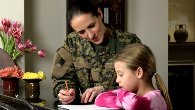 military mom helps daughter with homework - military school stock videos and b-roll footage