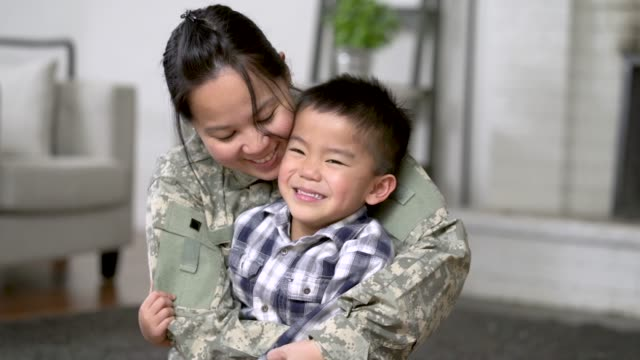 military mom hugging her son - military recruit stock videos & royalty-free footage