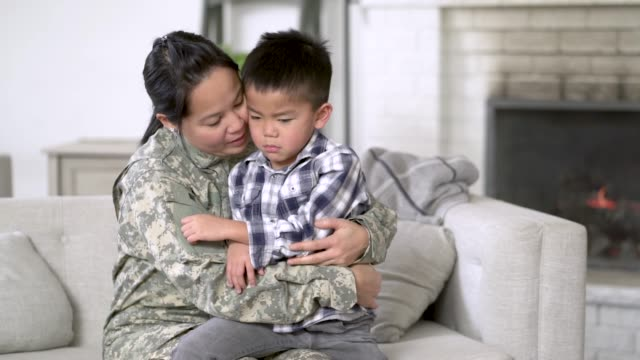 military mom hugging her son - military school stock videos and b-roll footage