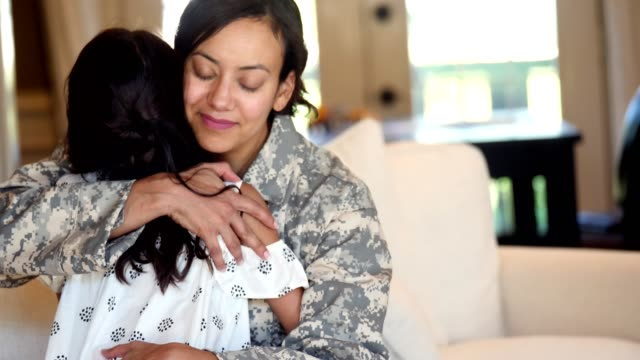 military mom is sad to leave her young daughter - embracing stock videos & royalty-free footage