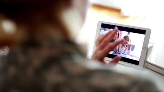 HD: Military Mom Talking With Her Children Over Tablet.