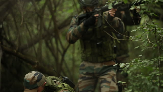 military moving through forest - mercenary human role stock videos & royalty-free footage