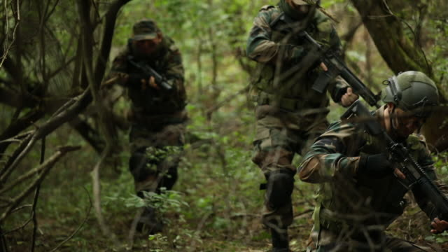 military moving through jungle - mercenary human role stock videos & royalty-free footage