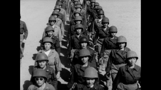 stockvideo's en b-roll-footage met / military nurses in drill formation / nurses marching up and down / individual marching nurses / view between two lines of marching women. wwii... - rampenoefening