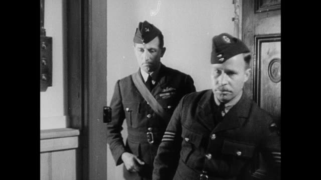 montage military officer walking down hallway and entering room to address a large group of soldiers / united kingdom - army soldier stock videos & royalty-free footage