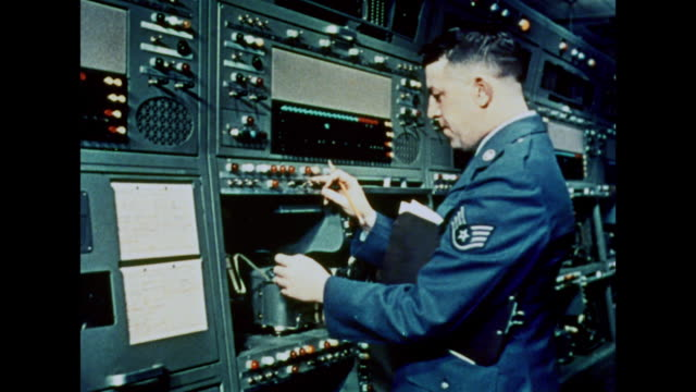 stockvideo's en b-roll-footage met 1964 a military officer walks through the sound archives - regelkamer