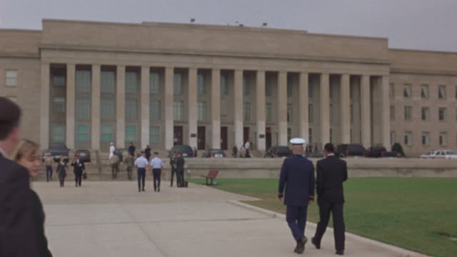 Military officers approaching the Pentagon.