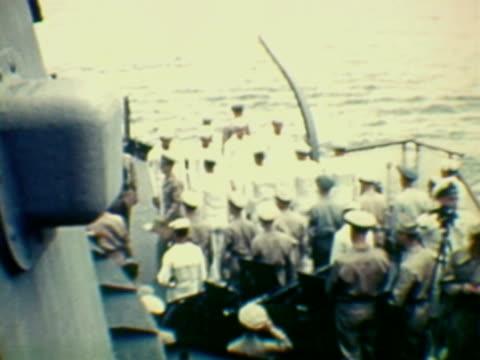MS HA COMPOSITE Military officers arriving on board of naval vessel during Japanese surrender