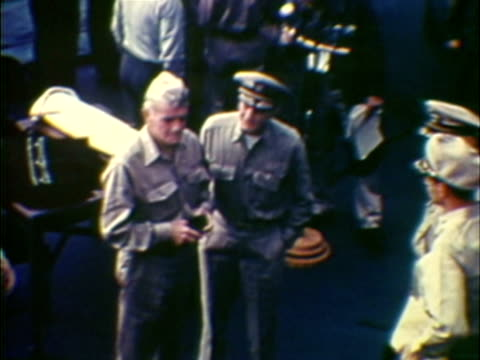 MS HA COMPOSITE Military officers on board of naval vessel during Japanese surrender