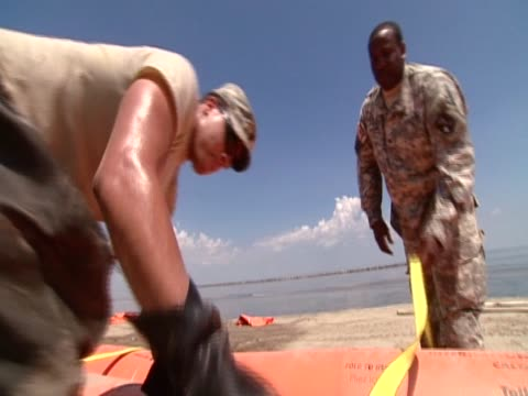 military officers participate in clean up operation following major oild spill along the gulf of mexico - 2010 stock videos & royalty-free footage