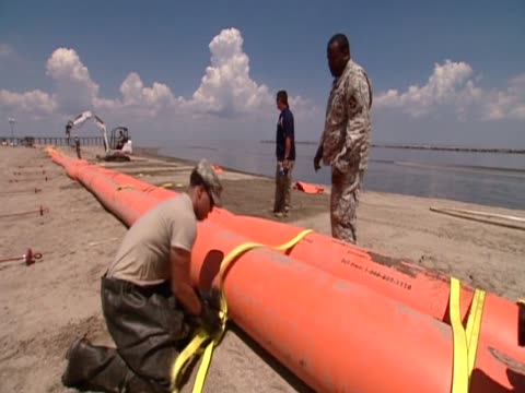 military officers participate in clean up operation following major oild spill along the gulf of mexico - major military rank stock videos and b-roll footage