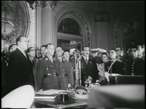 military officials + others in ornate room / new leaders of argentina after juan peron - 1955 stock videos & royalty-free footage