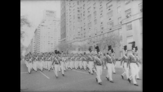 military parade along fifth avenue for armed forces day / armed cadets march in unison / crowd stand and applaud / cu polaris missile on float / cu... - parade float stock videos and b-roll footage