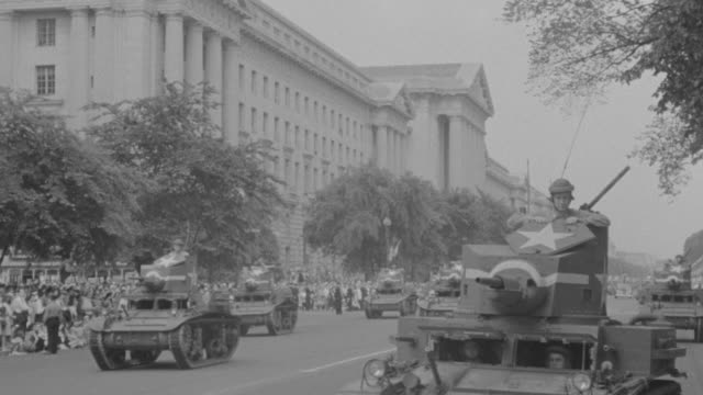 ms tu military parade as tanks driving in formation down constitution avenue in front of department of justice building in washington - armoured vehicle stock videos & royalty-free footage