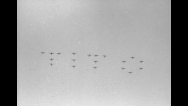 military parade from behind pan up to planes in sky / cu josip tito looking up pan up to planes / planes flying in formation spelling out tito /... - {{ contactusnotification.cta }} stock-videos und b-roll-filmmaterial
