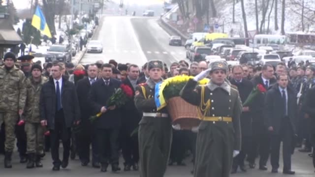A military parade is held in a memorial ceremony to mark the 97th anniversary of a battle near the small city of Kruty about 130 kilometers northeast...