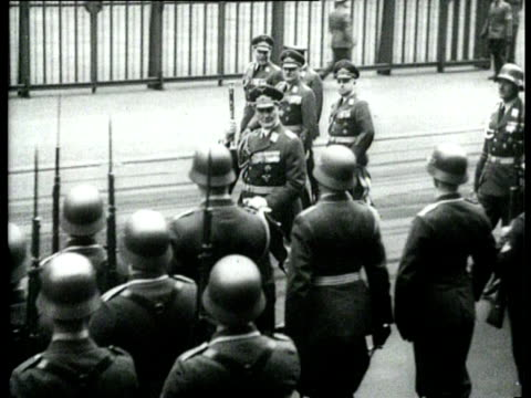 vidéos et rushes de a military parade of members of the various departments of the wehrmacht gsring takes the salute - wehrmacht