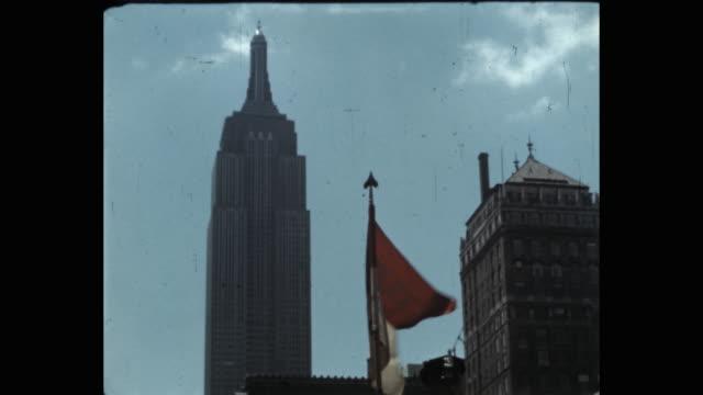 1941 military parade on 5th avenue, new york city, ny, usa - 旗棒点の映像素材/bロール