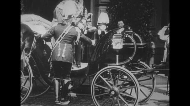 qs military parade on city street / royal person who may be gustaf v of sweden with military officers / ext palace with clock tower spire / king... - erster weltkrieg stock-videos und b-roll-filmmaterial