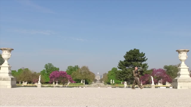 military patrol as part of vigipirate in front of the closed tuileries garden during the coronavirus epidemic on april 8 in paris france the country... - four people stock videos & royalty-free footage