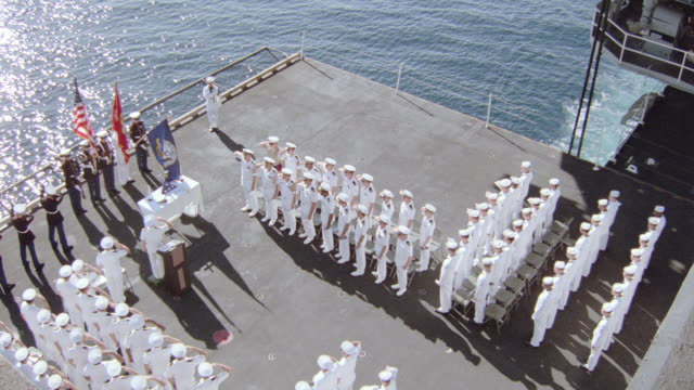 military personnel attend a funeral aboard an aircraft carrier. - warship stock videos & royalty-free footage