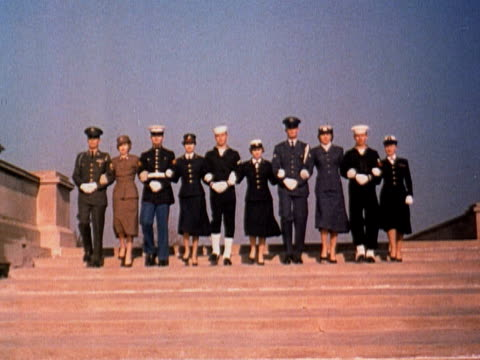 1960 WS US military personnel descending steps in dress uniforms arm-in-arm (from left: Army, Marines, Navy, Air Force, Coast Guard) / USA