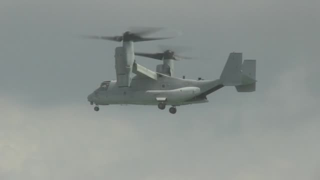military personnel from participating countries demonstrate the capabilities of their aircraft while performing for the singapore airshow 2014 on... - osprey stock videos & royalty-free footage