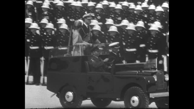 military personnel lined up in formation on parade ground in valetta / queen elizabeth ii and husband prince philip ride standing up in land rover... - land rover stock videos & royalty-free footage