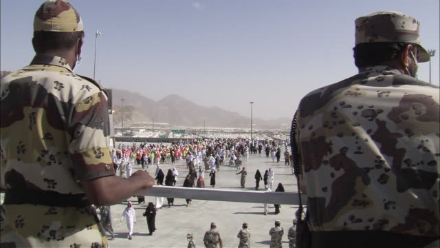 military personnel overlook a pilgrimage into mecca. - police force stock videos & royalty-free footage