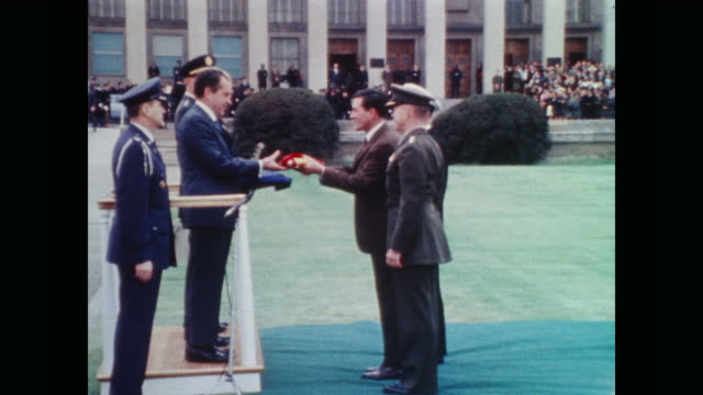 military personnel perform flag ceremony for president nixon outside pentagon - präsident stock-videos und b-roll-filmmaterial