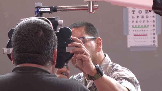 us military personnel provide free medical care during two week innovative readiness training exercise in ponce puerto rico april 29 2019 - ophthalmologist stock videos and b-roll footage