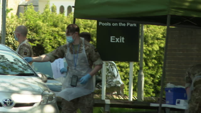 military personnel running drive through coronavirus testing centre london - army stock videos & royalty-free footage