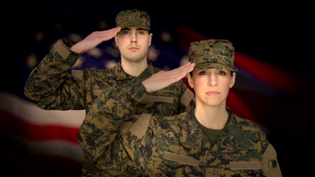 military personnel salute with us flag background - saluting stock videos & royalty-free footage