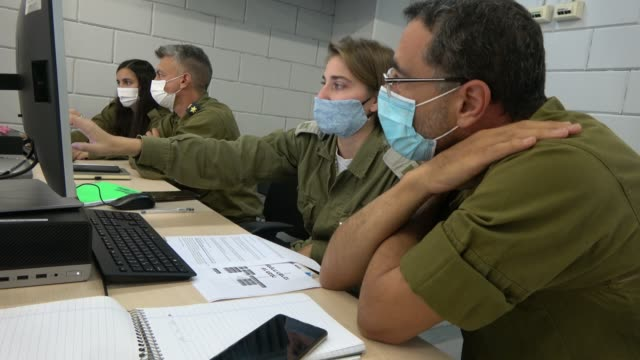 military personnel using computers to conduct epidemiological investigations at the israeli army's coronavirus task force headquarters on october 08,... - army soldier stock videos & royalty-free footage
