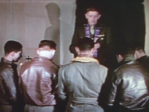 military pilots on their knees against priest in worship before an air raid - limb body part stock videos & royalty-free footage
