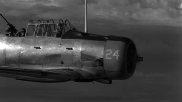 a 1943 military plane flies with a training gunner at the machine gun. - 1943 stock videos & royalty-free footage