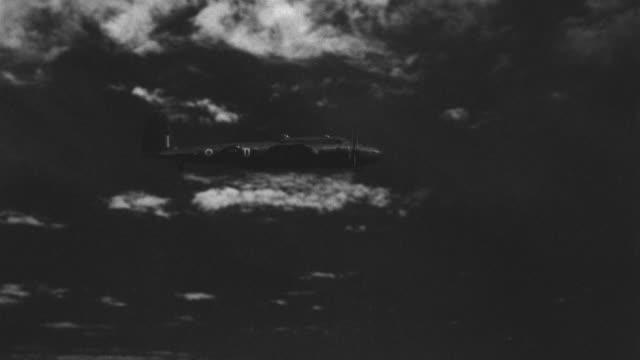ms ts military plane flying through clouds at night - stealth stock videos & royalty-free footage