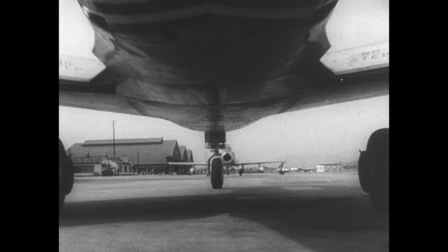 military planes lined up for takeoff, pilots in cockpits signaling each other / man pulls out fuel hose from f-86 sabre airplane and replaces cover /... - cockpit stock-videos und b-roll-filmmaterial