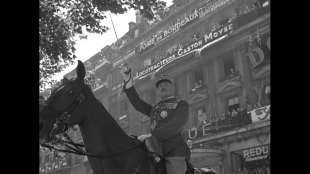military planes probably british air force fly overhead at french bastille day parade in paris / french president albert lebrun raises lowers sword... - british military stock videos and b-roll footage
