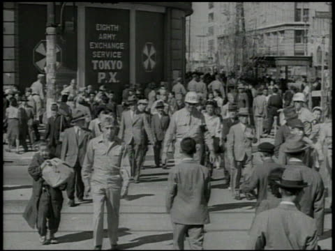 military police jeep driving, turning on street, various united states soldiers & japanese civilians walking on street, police on street, 'ginza... - pacific war video stock e b–roll