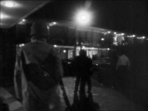 b/w 1968 military police outside motel at night where ml king was assassinated / newsreel - 1968年点の映像素材/bロール