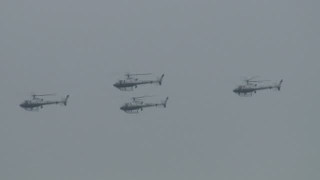 hd: military, police, security helicopters flying in formation past masts - police boat stock videos and b-roll footage